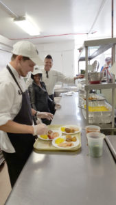 Cafe ML chefs preparing tray of food